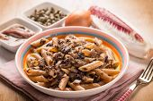 stock photo of chicory  - macaroni with red chicory anchovy and capers - JPG