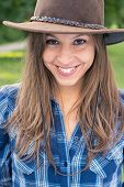 picture of cowgirl  - Brunette cowgirl smiling - JPG