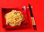 pic of carbonara  - spaghetti carbonara served on a red blackground - JPG