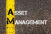 pic of asset  - Concept image of Business Acronym AM as ASSET MANAGEMENT written over road marking yellow paint line - JPG