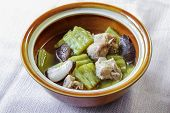 stock photo of bitters  - Bitter Melon soup with sparerib and mushroom in a bowl - JPG