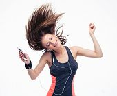 picture of hair motion  - Beautiful woman with headphones in dancing motion - JPG
