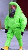 stock photo of biological hazard  - man with green protective suitagainst biological risk - JPG