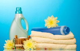 pic of detergent  - Detergent in bottles and towels isolated on blue background - JPG