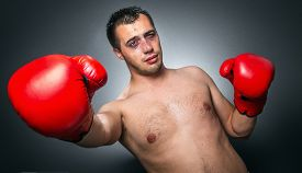 picture of knockout  - Funny boxer man in knockout over dark gray background - JPG