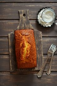 foto of mandarin orange  - cake tangerine on a dark wooden surface - JPG