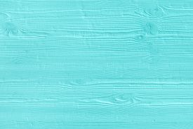 stock photo of wooden fence  - Natural wooden turquoise boards wall or fence with knots - JPG