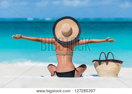 poster of Summer vacation happy carefree joyful bikini woman arms outstretched in happiness enjoying tropical