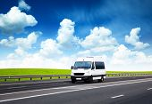 stock photo of motor coach  - van on road and perfect summer day - JPG