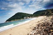 stock photo of atonement  - sand beach and cloudy sky in Greece - JPG