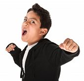 foto of spoiled brat  - Young Hispanic kid showing fist and ready to fight on white background - JPG