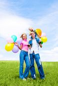 stock photo of family fun  - happy family with balloons outdoor on a summer day - JPG
