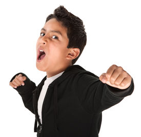 picture of spoiled brat  - Young Hispanic kid showing fist and ready to fight on white background - JPG