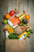 Grocery Shopping Concept. Balanced Diet Concept. Fresh Foods With Shopping Bag On Rustic Wood Backgr poster