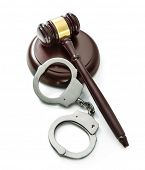 Handcuffs and Judge Gavel isolated on white background poster