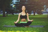 Young Woman Outdoors, Meditation Exercises. Girl Doing Lotus Pose For Relaxation With Closed Eyes. W poster