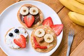 Pancakes With Funny Faces Decorated For Kids. Healthy Fruit Pancakes For Kids Meal poster