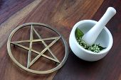 pic of magickal  - Closeup of wicca spell tools and book of shadows with mortar and pestle - JPG