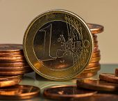 Coin One Euro. Coin On A Blurred Background Coin Denomination Of One Euro. Currency Of The European  poster
