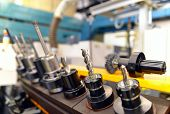 Close Up Of Cnc Mechanical Tools For Production Of Engineering Parts poster