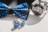Black Leather Shoes, Watch, Blue Bow Tie And Cufflinks, On A White Window Sill. Accessory For Formal poster