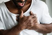 Black man having a heart attack poster