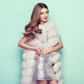Fashion Portrait Young Woman In White Fur Coat. Girl With Elegant Hairstyle Posing On A Colored Back poster