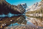 Dream Lake and reflection with mountains in snow around at autumn. Rocky Mountain National Park in C poster
