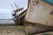 stock photo of old boat  - Damages ships in a harbour in France - JPG