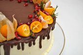 Piece Of Cake With Chocolate Icing And Citrus Decoration. Tangerine Cake, With Pomegranate Seeds. Cl poster