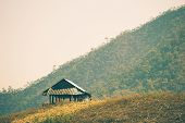The Hut Among The Mountains Is Surrounded By Forests In Summer. The Concept Of Seclusion Is Truly Bl poster