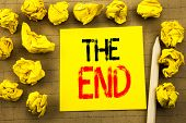 The End. Business Concept For End Finish Close Written On Sticky Note Paper On Vintage Background. F poster