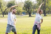 Couples Are Exercising In The Park. poster