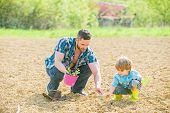 Small Boy Child Help Father In Farming. New Life. Soils And Fertilizers. Rich Natural Soil. Earth Da poster