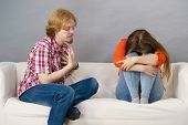 Woman And Man After Argue On Sofa poster
