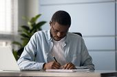 Focused Mixed Race Entrepreneur Signing Document Or Contract. poster