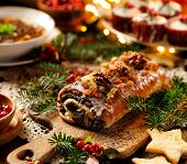 Christmas Poppy Seed Cake,covered With Icing And Decorated With Raisins And Walnuts On The Holiday T poster