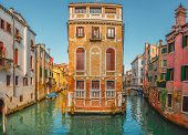 View Of The Street Canal In Venice, Italy. Colorful Facades Of Old Venice Houses Standing In Water.  poster