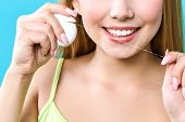 Young Beautiful Woman Is Engaged In Cleaning Teeth. Beautiful Smile Healthy White Teeth. A Girl Hold poster