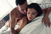 Passionate Young Couple Having Sex In Bed At Home poster