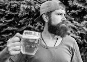 The Most Hipster Drink Ever. Hipster Man With Craft Beer On Summer Day. Hipster Drinker Holding Beer poster