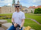 Manduring Sightseeing Old Castle In Cracow, Wawel. Summer Time poster