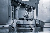 Metalworking CNC lathe milling machine. Cutting metal modern processing technology. Milling is the p poster