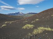 Icelandic Black And Red Lava Desert Landscape With View On Tindfjallajokull Glacier Mountains And Gr poster
