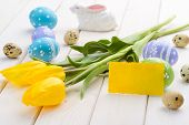 Yellow Card, Fresh Tulips. Pastel Easter Eggs. A Ceramic Bunny And Quail Eggs On The Light Wooden Su poster