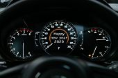 Close Up Instrument Automobile Panel With Odometer, Speedometer, Tachometer, Fuel Level, Which Says  poster