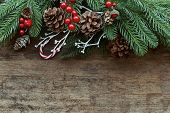Christmas Wood Texture Decorate With Pine Leaves, Pine Cones, Holly Balls And Candy Cane In Christma poster