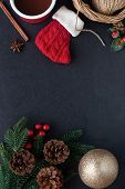 Black Granite Decorate With Red Sock, Pine Leaf And Cones, Holly Balls, Golden Ball And Cup Of Choco poster