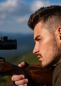 Snipers Carbine At The Outdoor Hunting - Close Up Portrait. Hunter Man. A Hunter With A Hunting Gun  poster