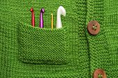 Crafted Concept. Handmade Background. Crochet Hooks In Green Pocket. Fragment Of Handmade Clothing W poster